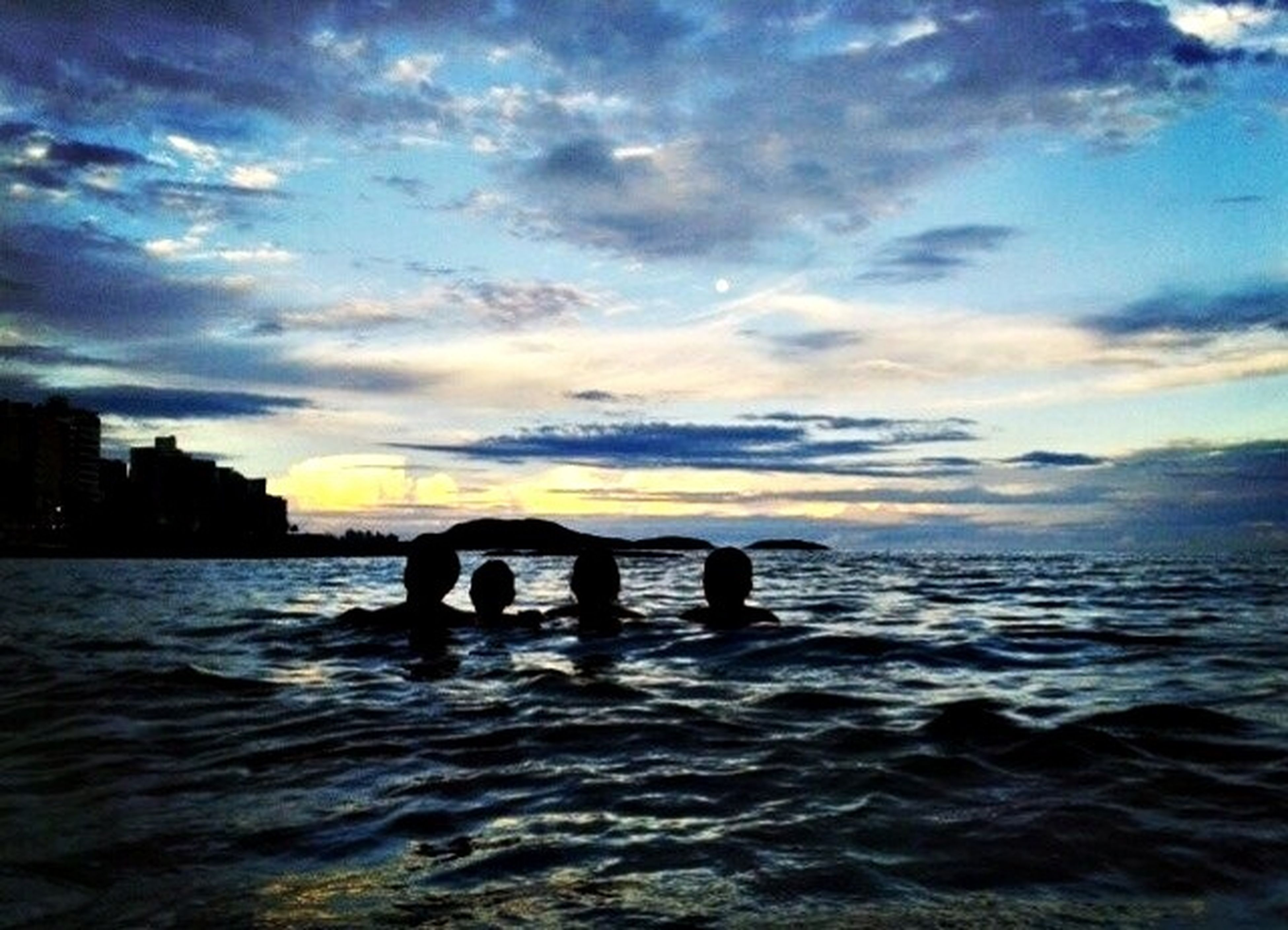 water, sunset, sky, sea, cloud - sky, silhouette, leisure activity, lifestyles, waterfront, scenics, men, horizon over water, beauty in nature, beach, cloud, nature, tranquil scene, reflection