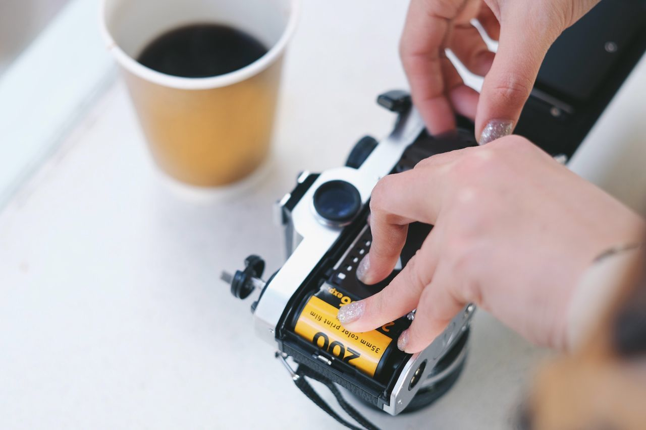 Film photography Human Hand Holding Close-up High Angle View Indoors  Working Camera Film Photography Filmisnotdead 35mm 35mm Film Analog Analog Photography Classic Coffee Americano Black Coffee Artist Photographer