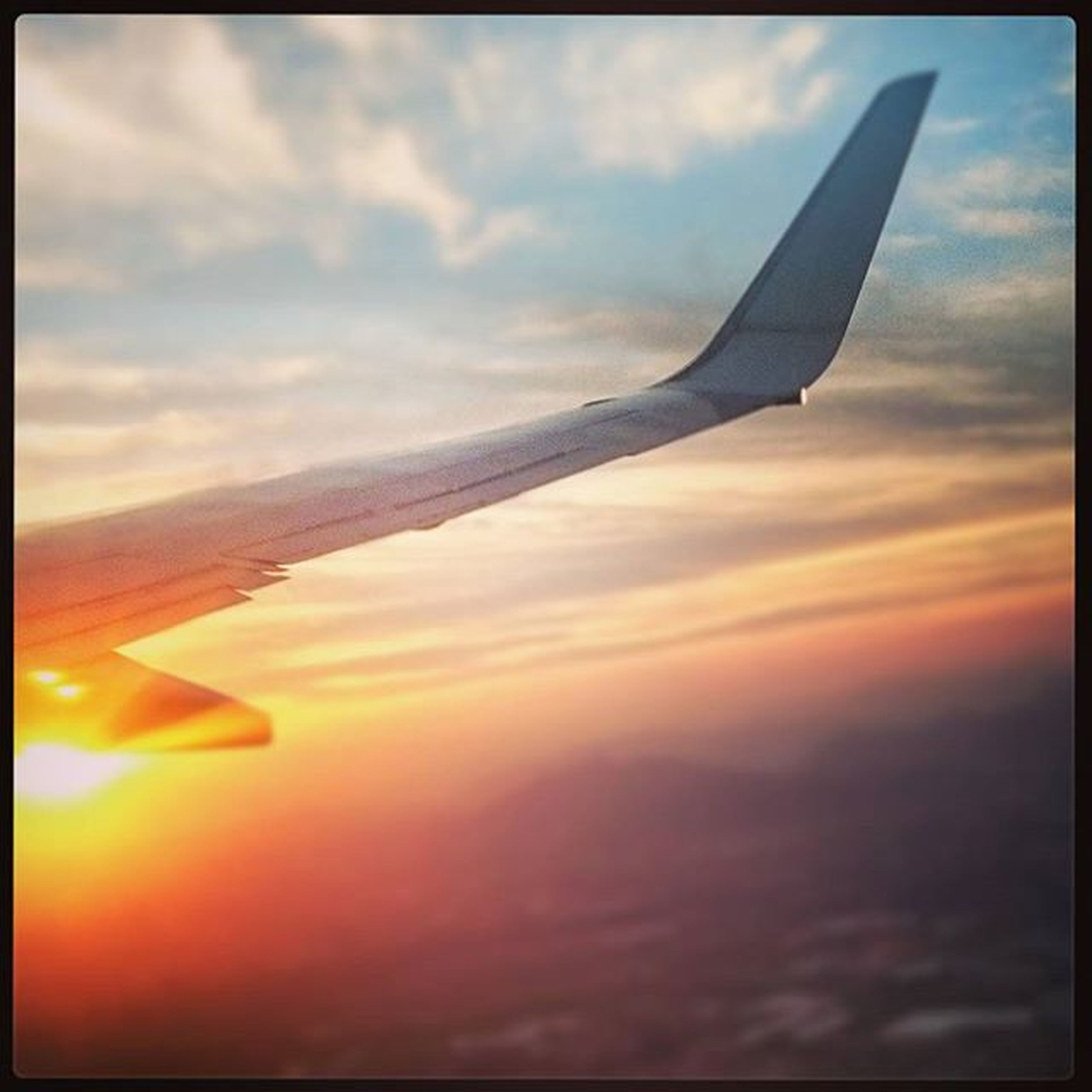 sunset, sky, transfer print, flying, cloud - sky, auto post production filter, beauty in nature, scenics, cloud, nature, airplane, tranquil scene, tranquility, orange color, cloudy, transportation, part of, cloudscape, aircraft wing, mid-air