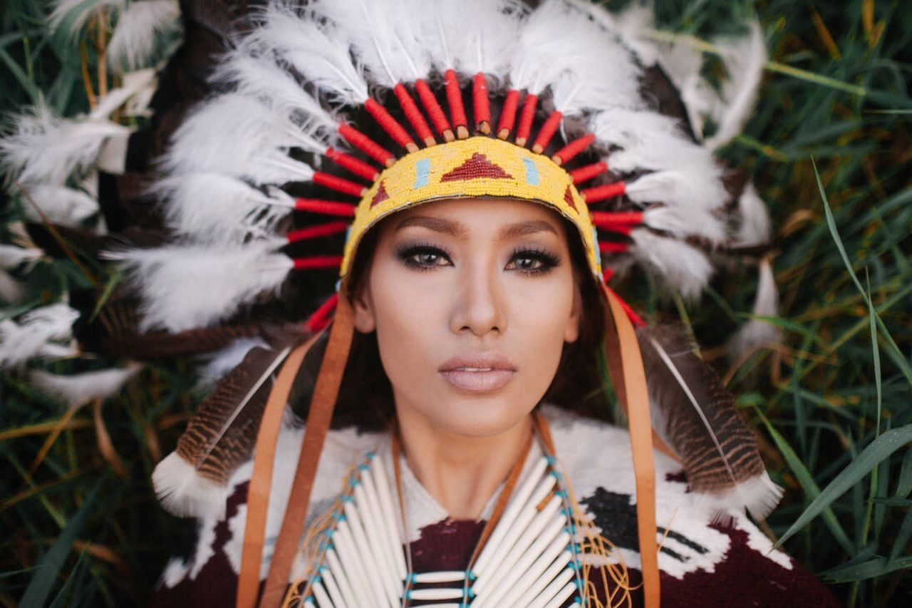 The Portraitist - 2017 EyeEm Awards Headshot Headdress One Person Only Women Young Adult One Woman Only Adults Only One Young Woman Only Adult Front View Portrait Close-up Feather  People Laurel Wreath Day Crown Outdoors Beautiful Woman Flower Native American Indian