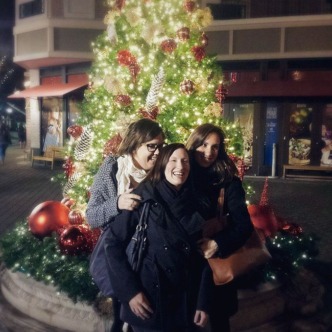 Laughing at the boys trying to take pics of us in front of the tree.