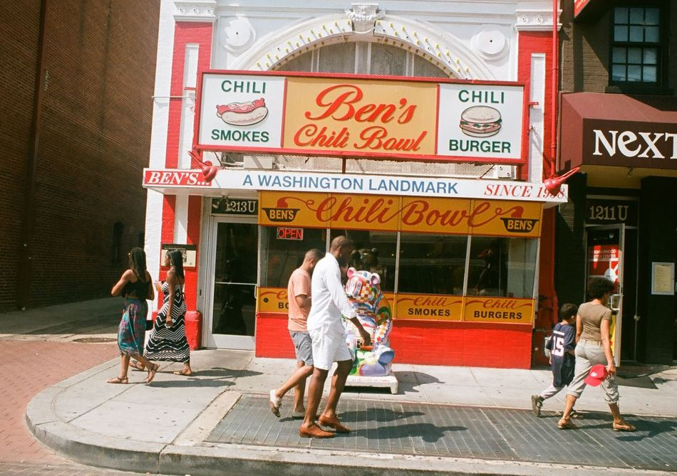 The exterior of Ben's Chili Bowl restaurant in Washington, DC. Ben's Chili Bowl Building Exterior City Life Communication Cultures Large Group Of Objects Men Pedestrian Perspective Retail  Sign Store Street Street Scene Text Variation Washington, D. C. Western Script Women