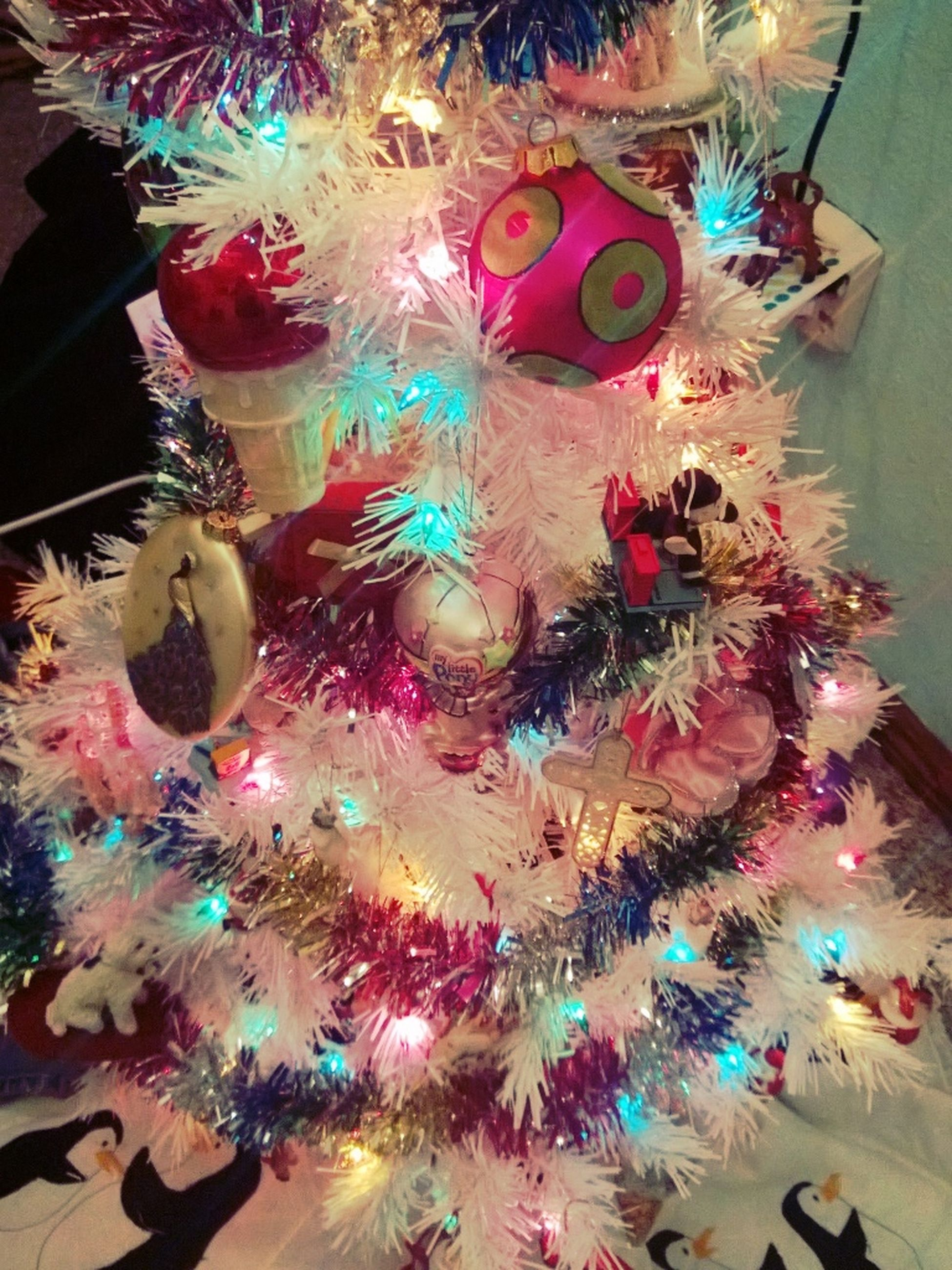 indoors, multi colored, art and craft, illuminated, art, celebration, decoration, creativity, variation, high angle view, colorful, animal representation, large group of objects, no people, christmas, celebration event, still life, arts culture and entertainment, pattern, christmas decoration