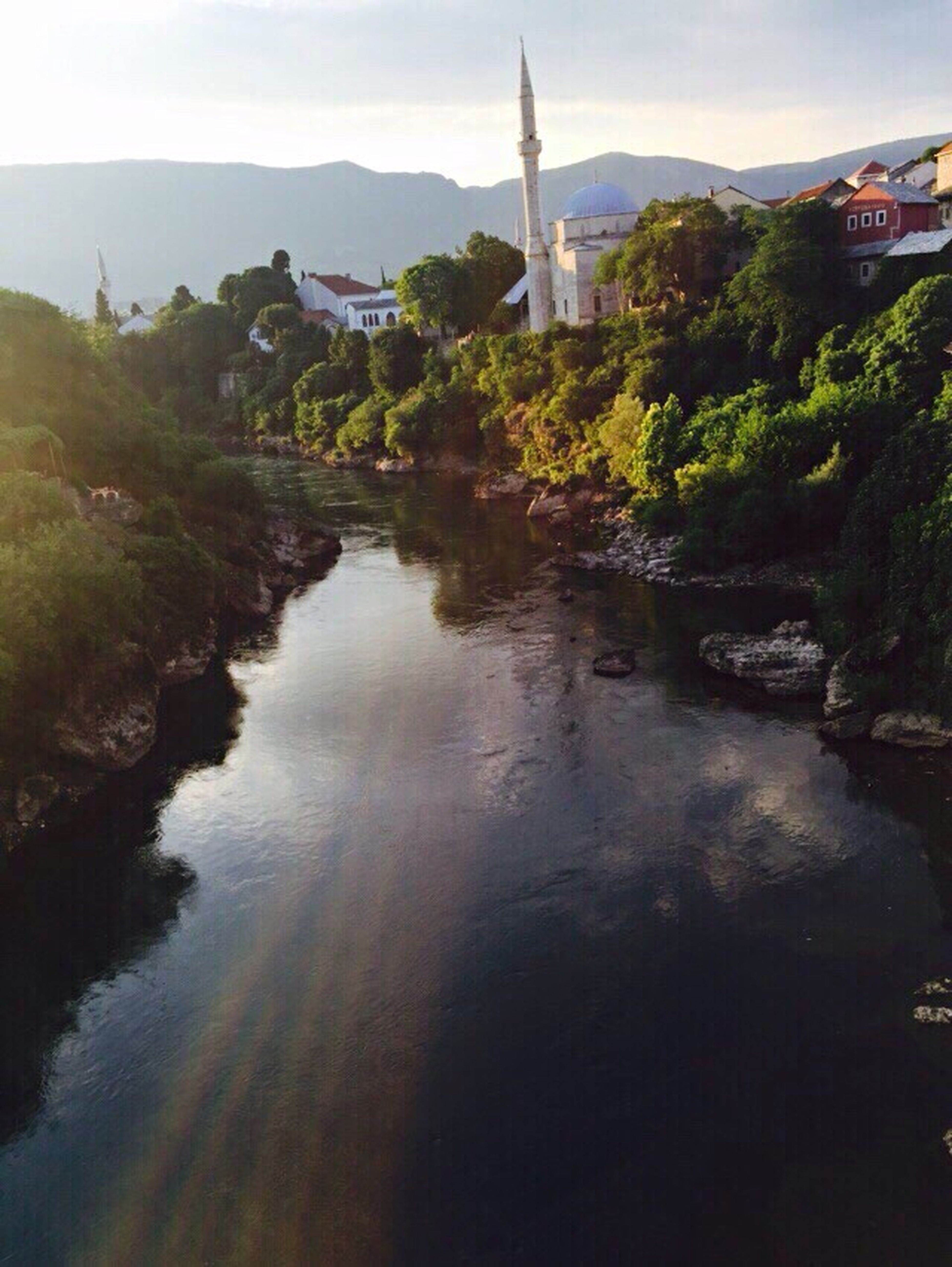 Water Architecture River Building Exterior Waterfront Mountain Rural Scene Tranquil Scene Tranquility Sky Mostar Bosnia Nature Riverbank Agriculture Scenics Day Alternative Energy Beauty In Nature Windmill Non-urban Scene