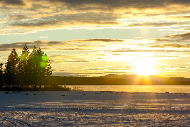 Sunset over Siljan Bay Lake Lake View Landscape Orange Sea Snowtrail Sunset Sunset Silhouettes Sunset_collection Winter