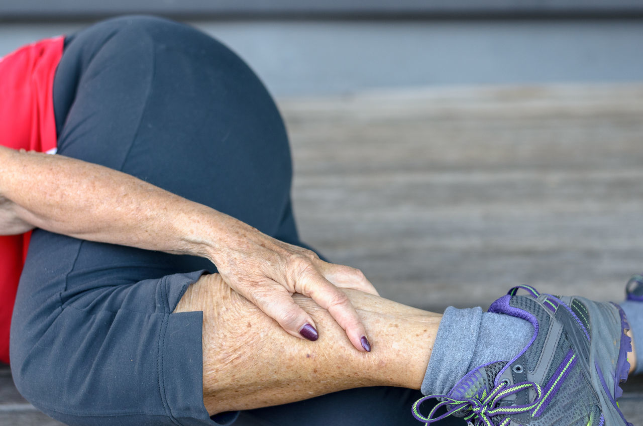 Low Section Of Senior Woman Suffering From Leg Pain