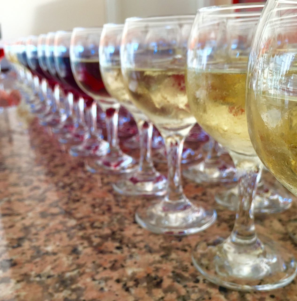 Close-Up Of Wineglasses Arranged In Row On Table