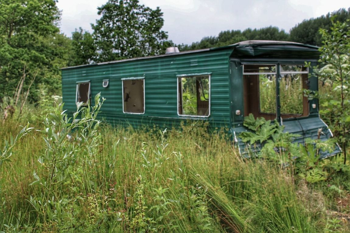 Outdoors Green Color No People Grass Day Tree Rural Scene Nature Sky Urban Exploration Lostintime Urban Scene Abandoned Mobilehome