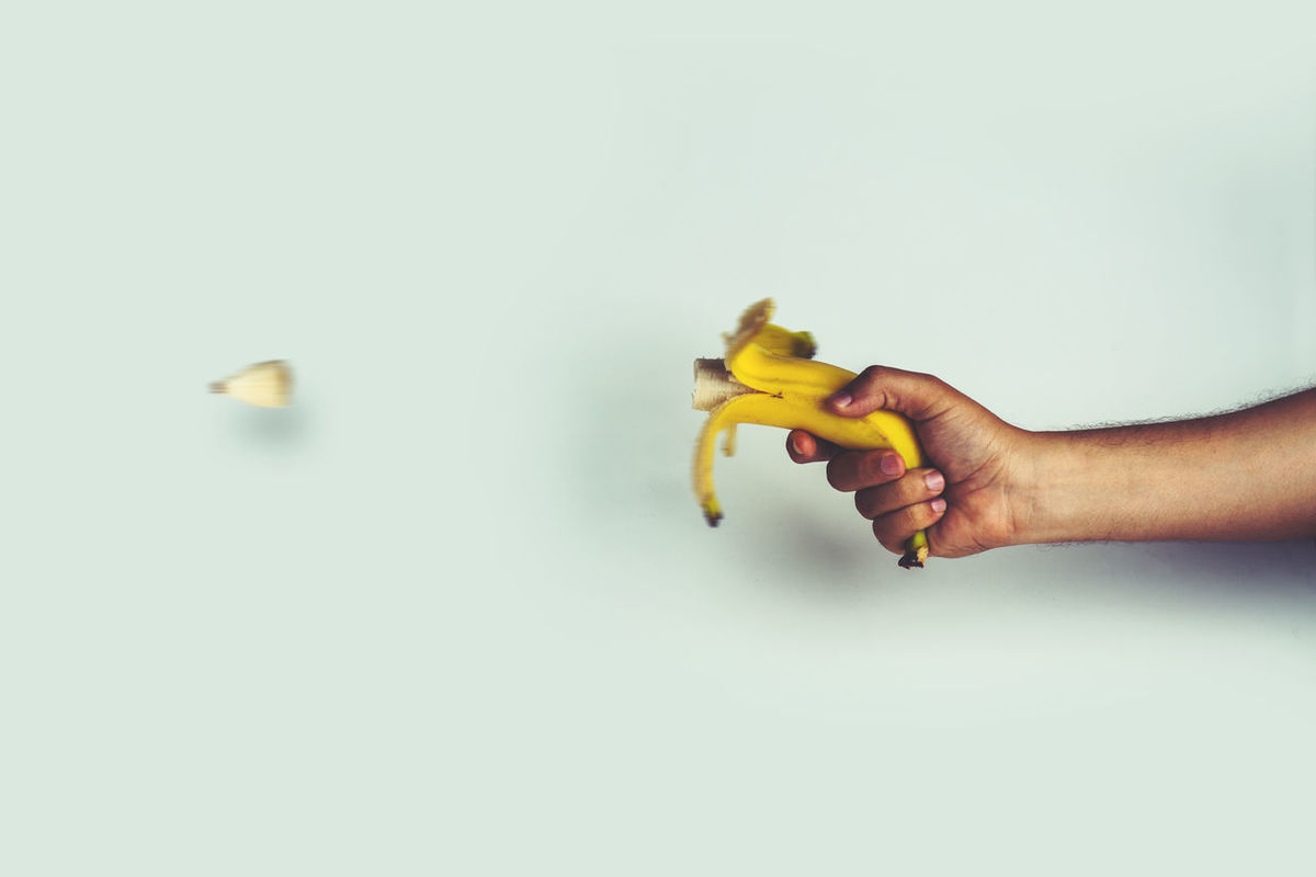 isolated hand holding a peeled banana and shooting like a gun Banana Creativity Diet & Fitness Gun Pop Art Close-up Conceptual Day Food And Drink Freshness Fruit Gun Shot Healthy Lifestyle Holding Human Body Part Human Hand Ideas Indoors  One Person Peeled People Real People Studio Photography Studio Shot White Background Mix Yourself A Good Time The Week On EyeEm Rethink Things
