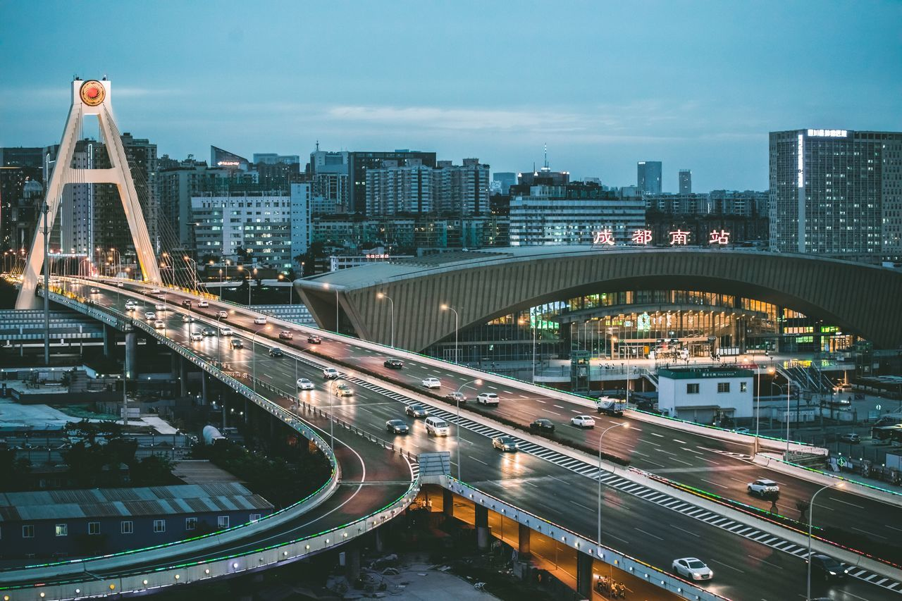 High Angle View Of Illuminated Bridge In City Against Sky