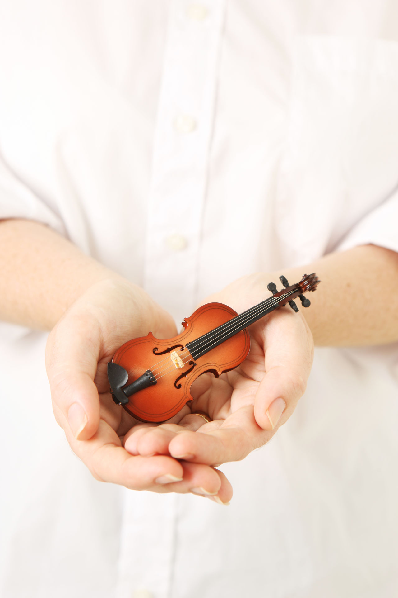 Violin Lessons Class Close-up Day Education High Key Holding Human Body Part Human Hand Indoors  Miniature Music Musical Instrument Musical Instruments Musician One Person People String Instrument Toy Violin Violin Lesson Violin Practice White Background