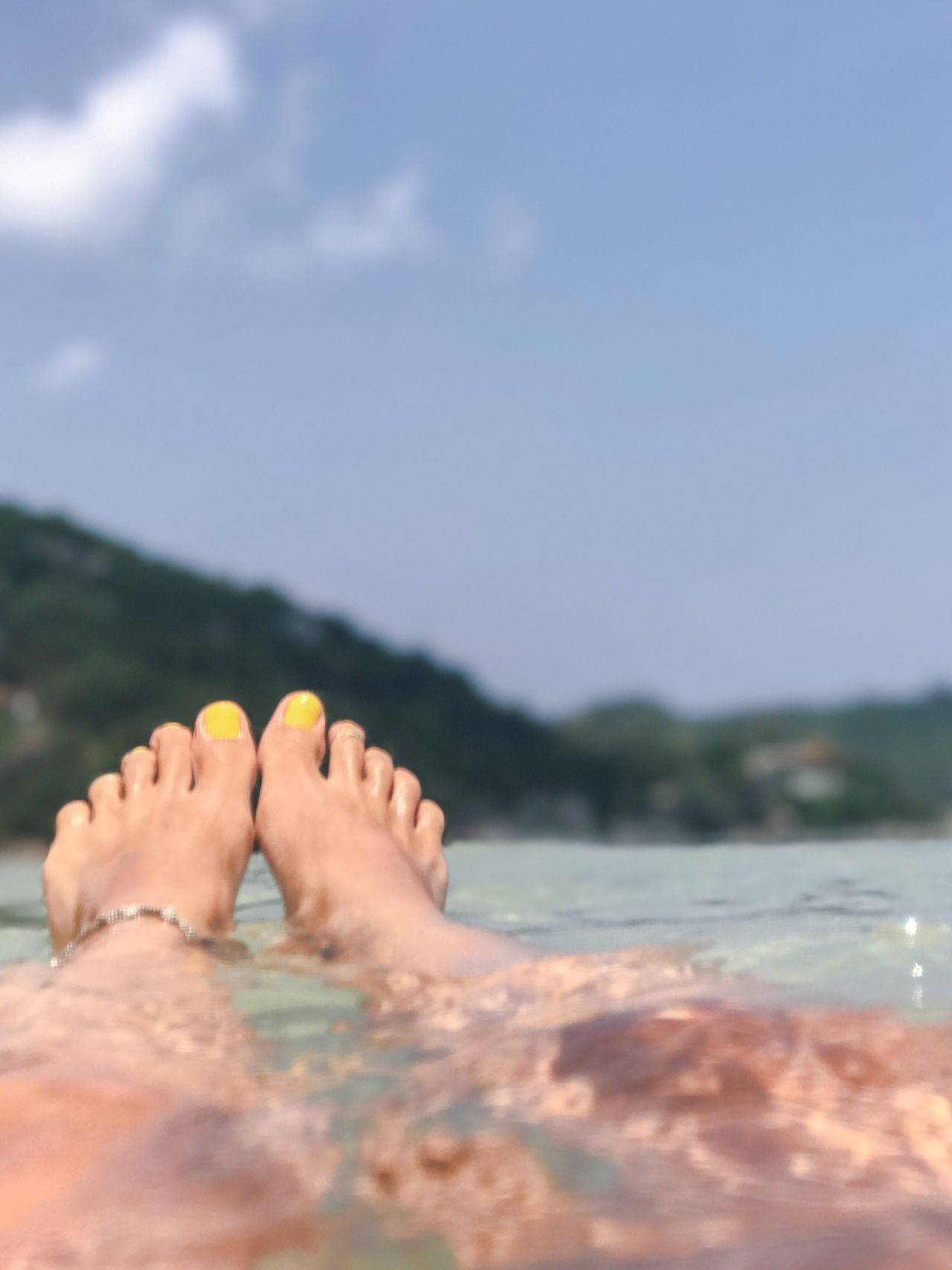 Barefoot Human Foot Low Section Human Leg Water Human Body Part Relaxation Real People One Person Outdoors Women Sea Leisure Activity Day Close-up Nail Polish Vacations Lifestyles Sky Nature Swimming Vacations Thailand Tropical Climate Travel Destinations