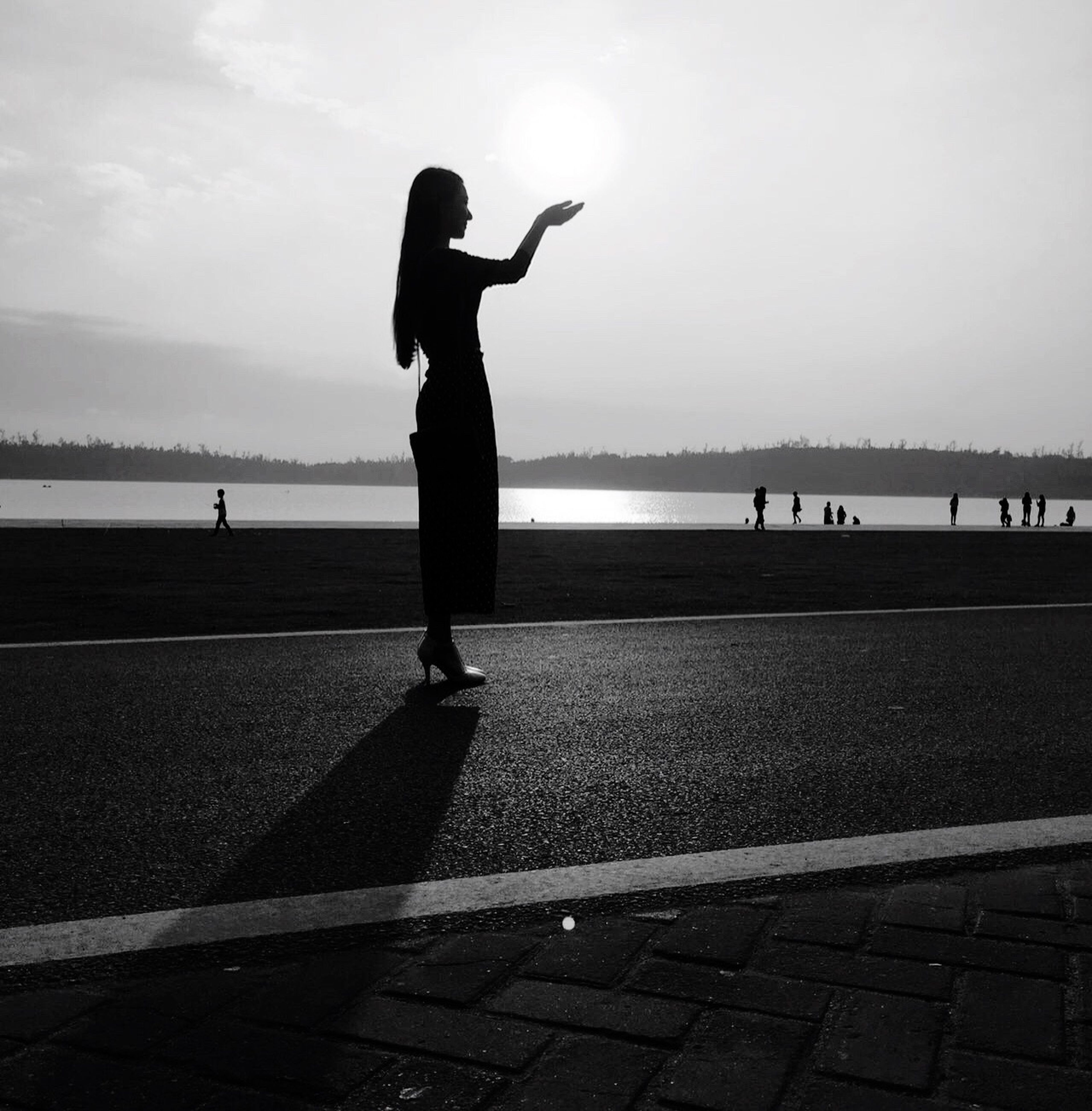 full length, lifestyles, leisure activity, sky, silhouette, men, sea, street, walking, side view, road, rear view, beach, person, outdoors, standing, sunlight, day
