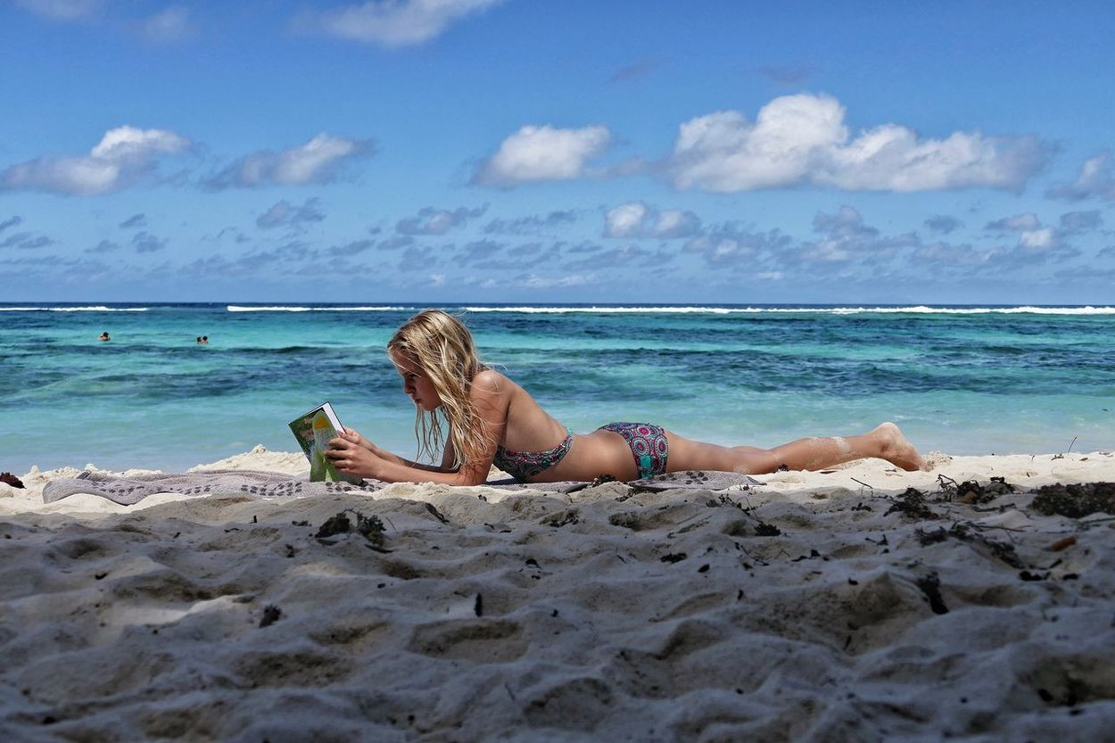 Sea Beach Sky Full Length Sand Real People Horizon Over Water Leisure Activity One Person Outdoors Day Nature Vacations Cloud - Sky Water Beauty In Nature People Girl Seychelles Beach Reading La Digue Anse Source D'argent