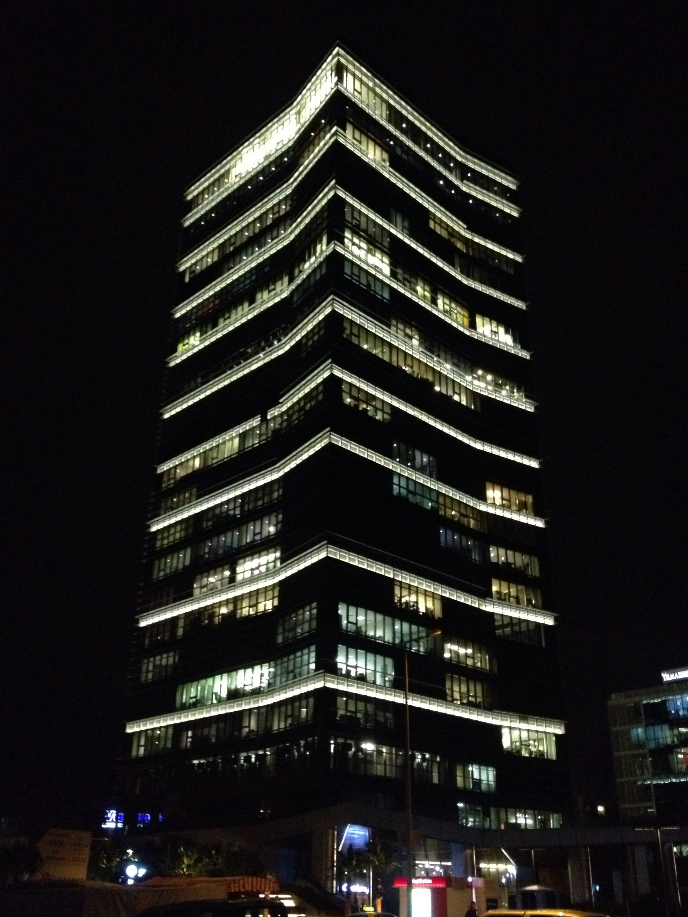 building exterior, architecture, built structure, city, skyscraper, night, illuminated, modern, office building, tall - high, low angle view, tower, building, city life, tall, sky, outdoors, financial district, capital cities, clear sky