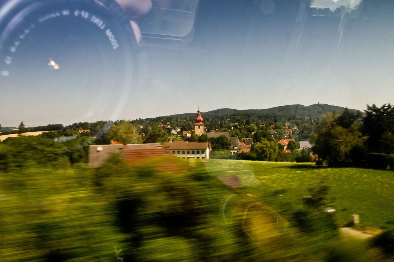 Traveling by train Small Town Moving Reflection Camera Trees Church Tower Traveling Nature Landscape Reflection In The Glass  Train Outdoors Day Austria