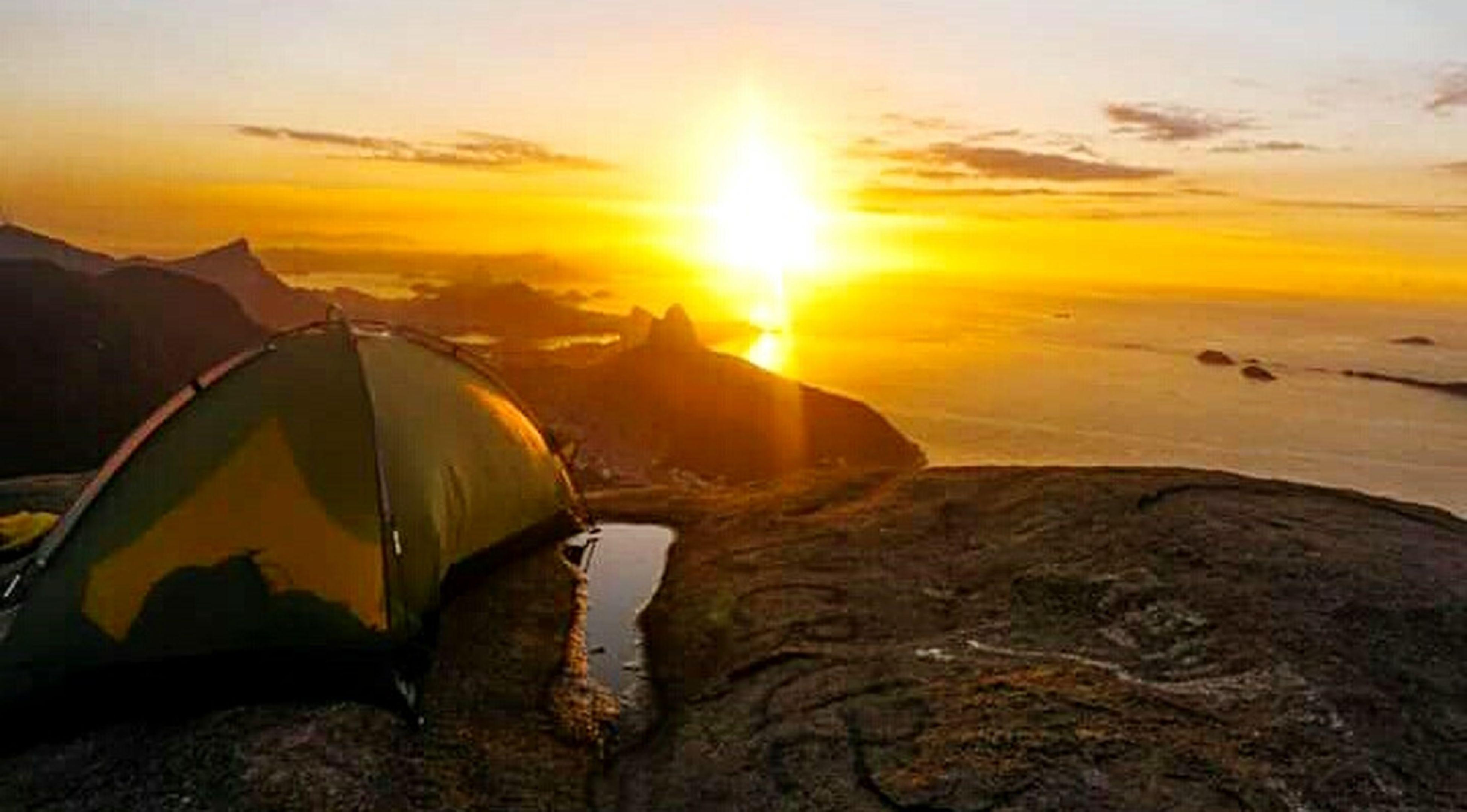 sunset, sunlight, sun, nature, beauty in nature, sky, water, landscape, sunbeam, scenics, outdoors, no people, sea, day