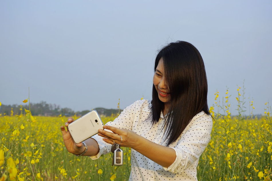 Beautiful Woman Nature One Person Only Women People Relaxation Smart Phone Smiling