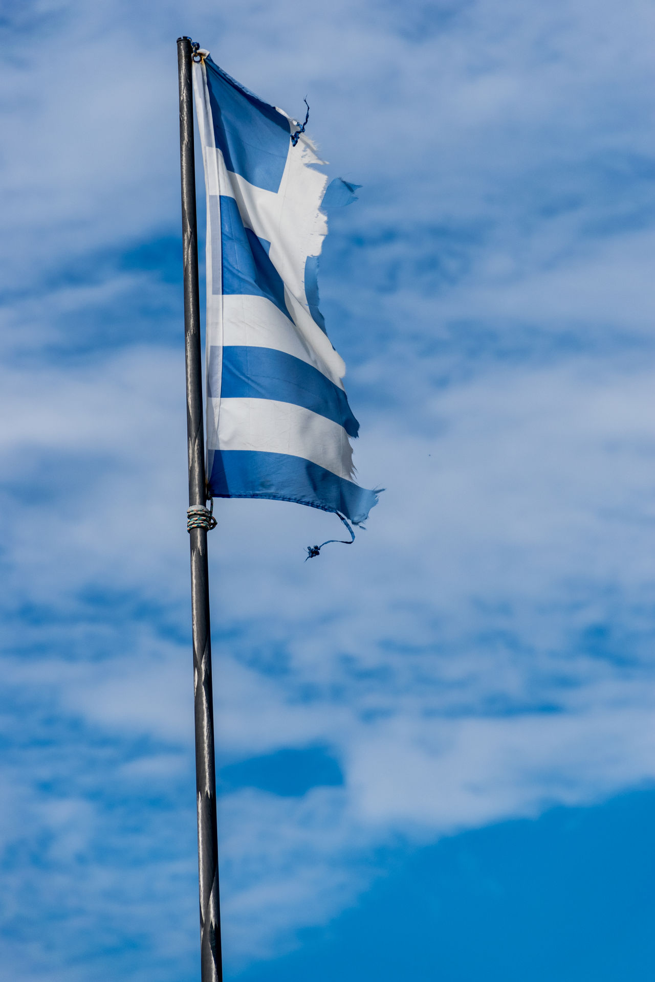 it really saddens me to see such a great country laying torn apart. This huge potential is just wasted on so many levels - no one takes care of the old cultural places... :-( Abandoned Blue Cloud - Sky Debt Flag Flags In The Wind  Greece Greek Greek Flag Greek Islands Greek Symbols No Money Poor  Ripped Ruined Shredded Sky Status Status Quo Tattered Torn White