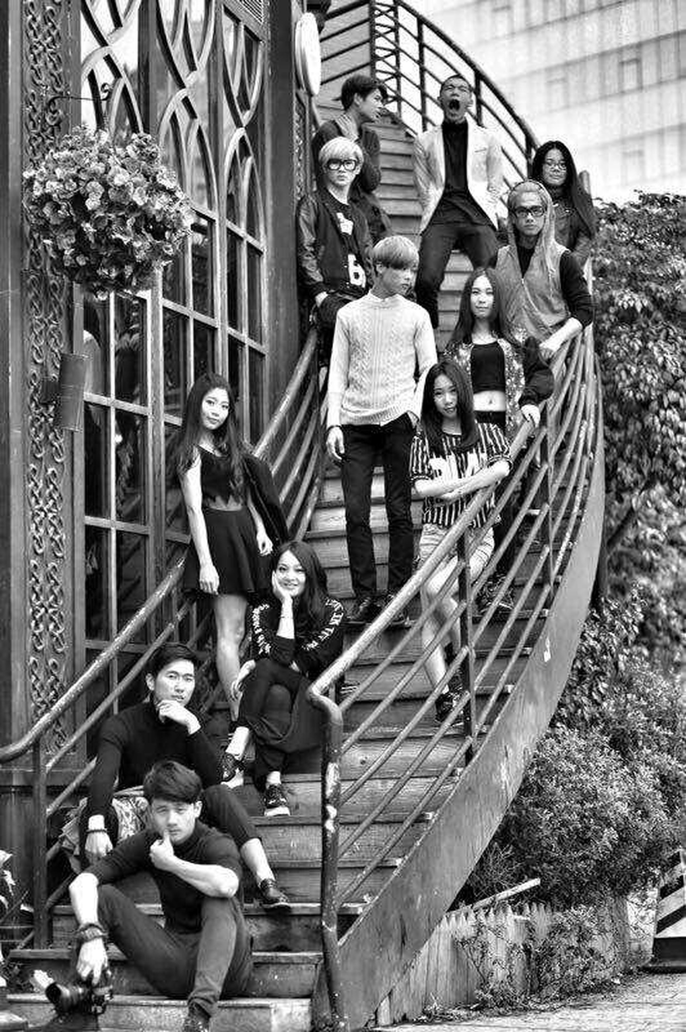 full length, lifestyles, casual clothing, leisure activity, childhood, boys, person, built structure, architecture, elementary age, girls, standing, men, day, railing, fun, togetherness