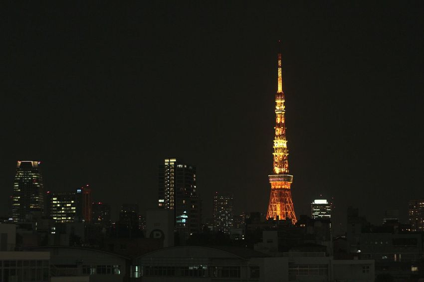 Tokyo at Night. Tower City Travel Destinations Architecture Skyscraper Illuminated Cityscape Urban Skyline Travel No People Building Exterior Tourism Arts Culture And Entertainment Monument Built Structure Modern Low Angle View Outdoors Sky