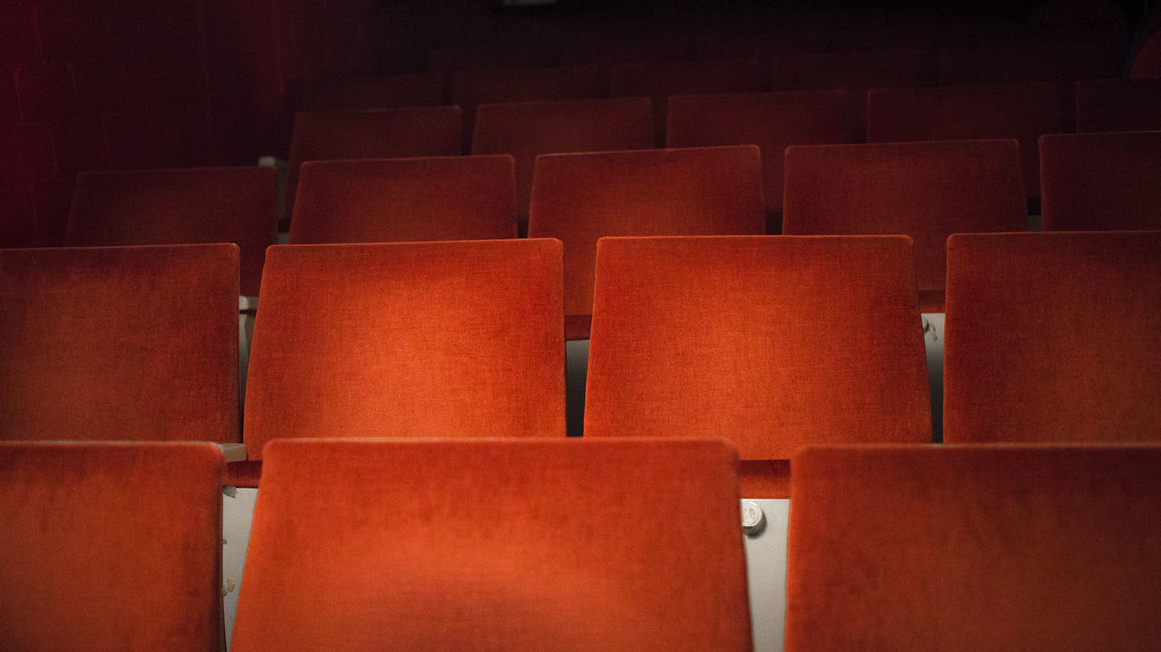 in a row, indoors, full frame, seat, backgrounds, auditorium, no people, chair, arrangement, close-up, day