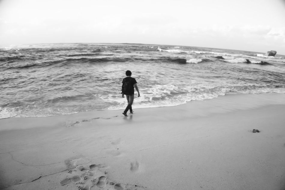 playing with our own shadow Adventure Beach Beauty In Nature Blackandwhite Day Full Length Horizon Over Water Leisure Activity Lifestyles Men Nature One Person Outdoors People Real People Rear View Sand Scenics Sea Sky Vacations Water Wave Youth Culture