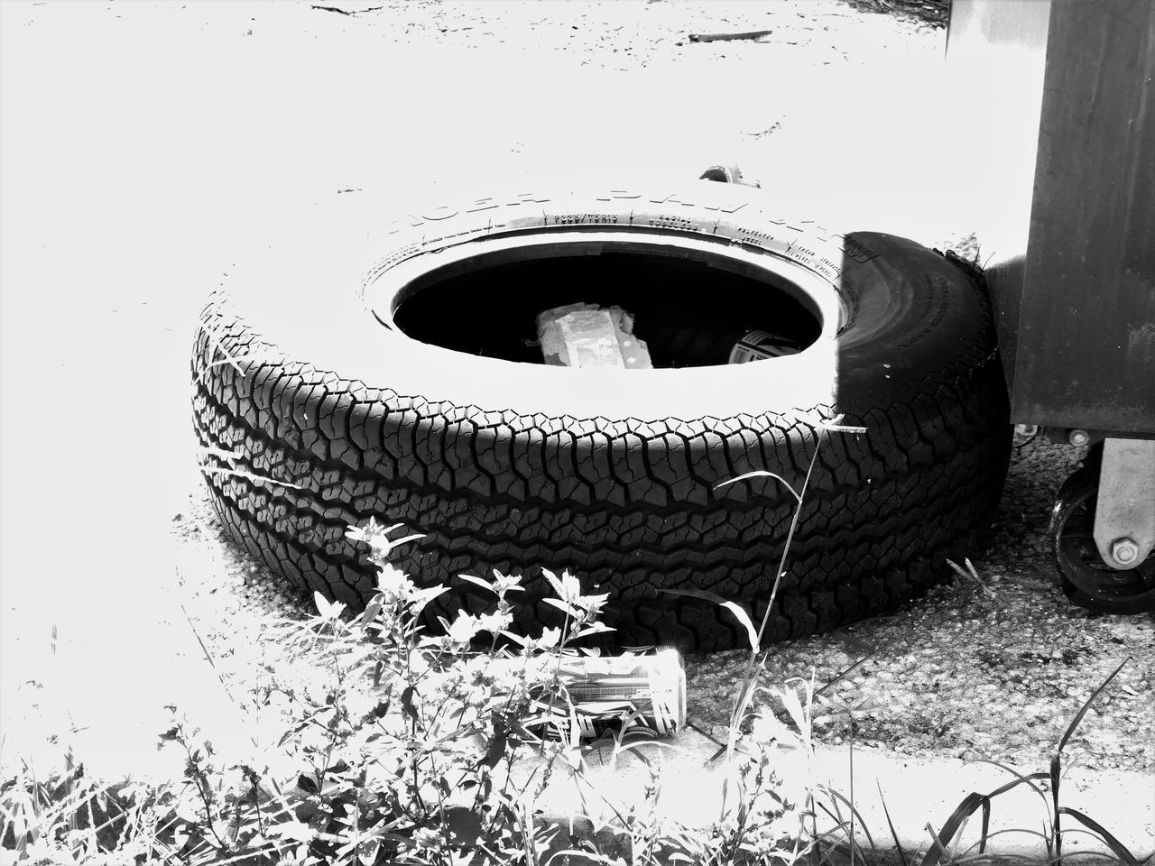 Monochrome Photography Blackandwhite Darkness And Light Outdoors Tire Trash Dumpster Odd Strange Random Acts Of Photography Notes From The Underground Light And Shadow On The Road Circles And Holes Littering Rubbish Waste Waste Management One Mans Trash Is Another Mans Treasure Circle Unwanted Textures And Surfaces Streetphotography Garbage