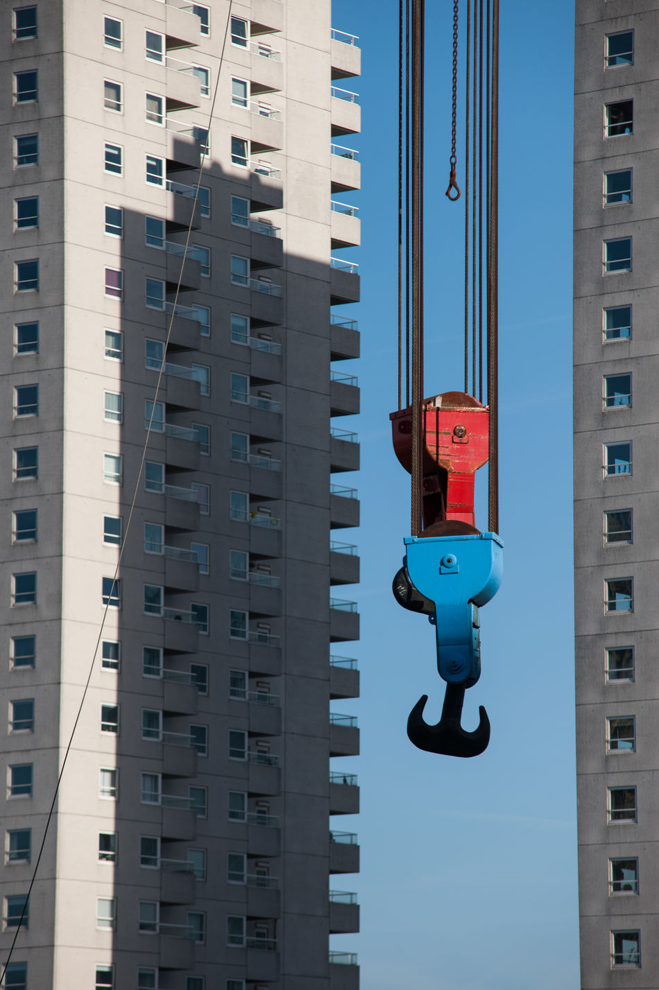 Red and blue Architecture Building Exterior Built Structure City Clear Sky Color Colorful Contrast Crane Day Industrial Modern No People Outdoors Shadow Sky Skyscraper