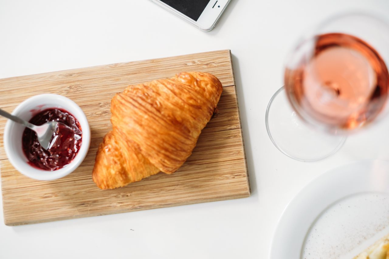 Croissant with jam and a glass of rose wine Morning Light Nature Photography Food And Drink Food Table Croissant Bread Breakfast High Angle View Freshness Healthy Eating French Food Ready-to-eat No People Sweet Food Mobile Devices