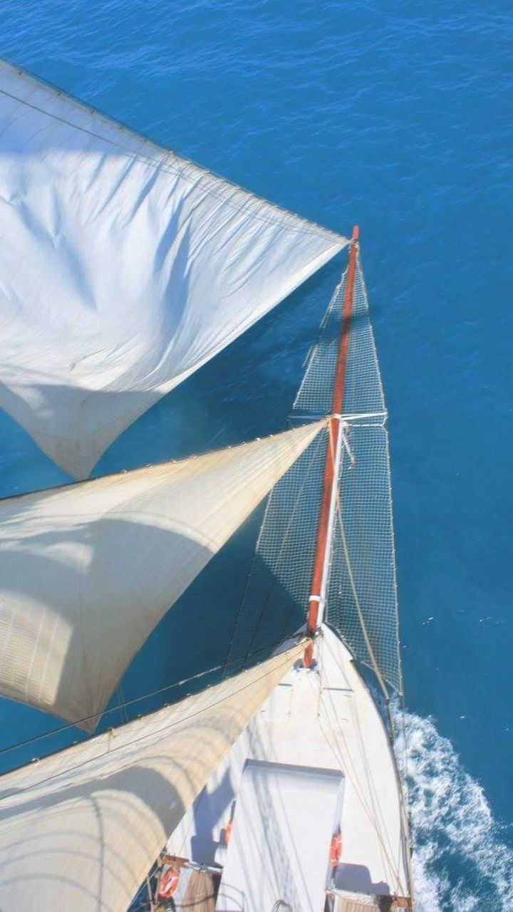 nautical vessel, sailing, outdoors, sunlight, sea, sailboat, no people, summer, yacht, day, blue, vacations, sailing ship, nature, water, sky, yachting