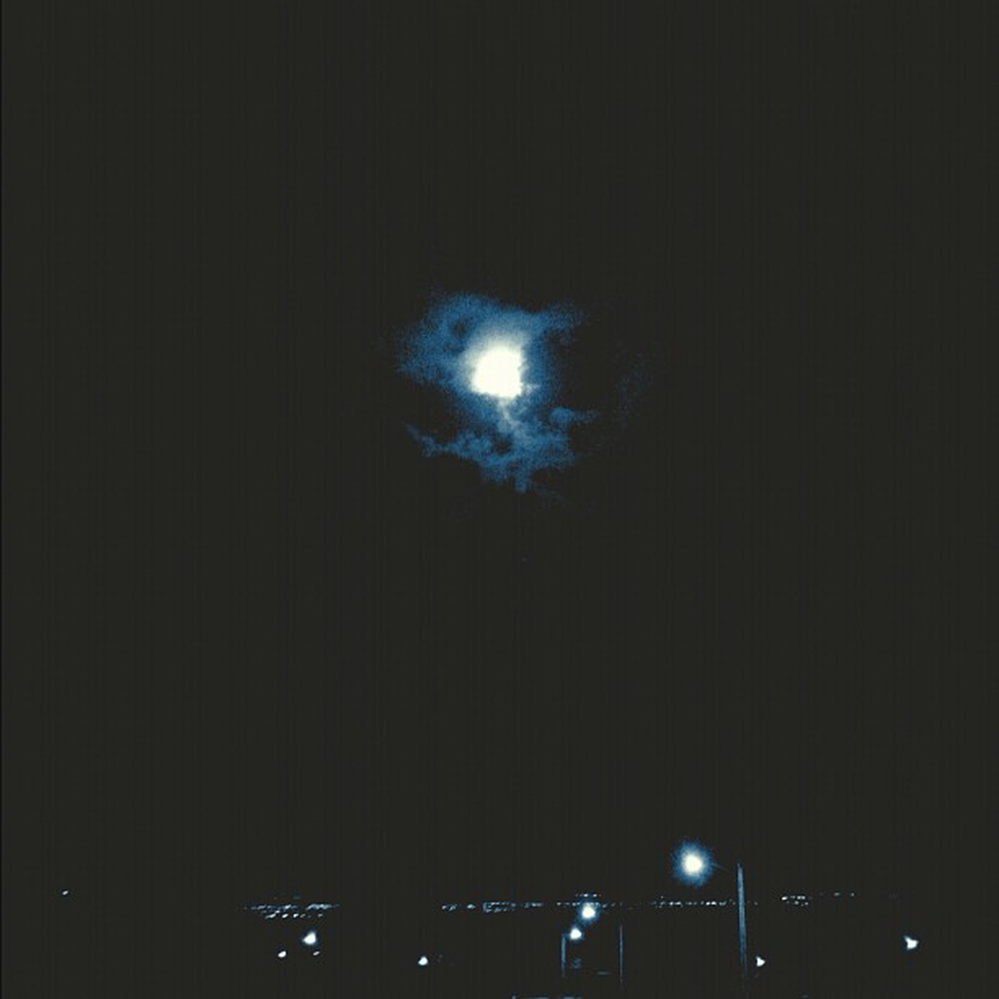 night, illuminated, lighting equipment, dark, low angle view, light - natural phenomenon, street light, copy space, built structure, electricity, architecture, glowing, no people, electric light, moon, window, light, building exterior, outdoors