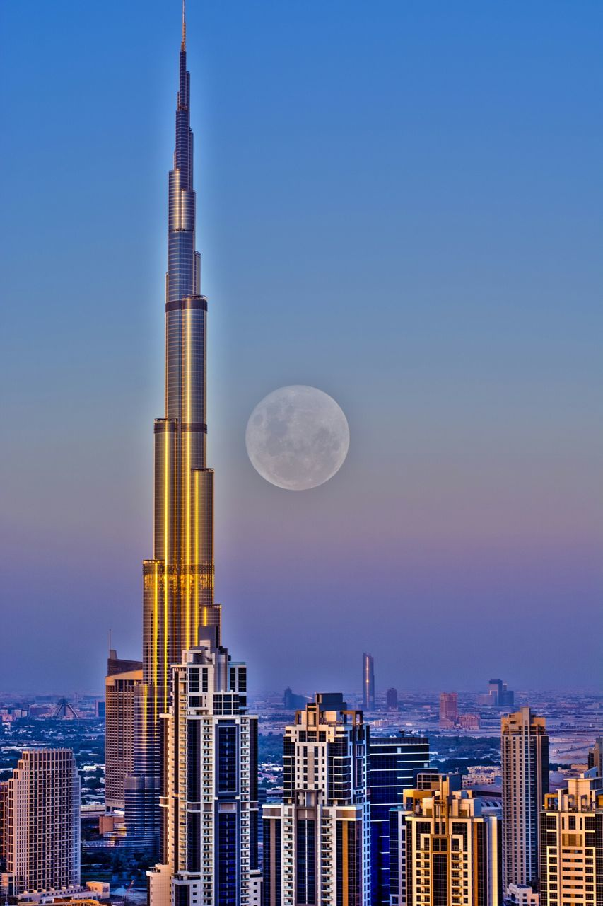 architecture, building exterior, built structure, city, moon, skyscraper, cityscape, no people, clear sky, travel destinations, outdoors, sky, day, nature