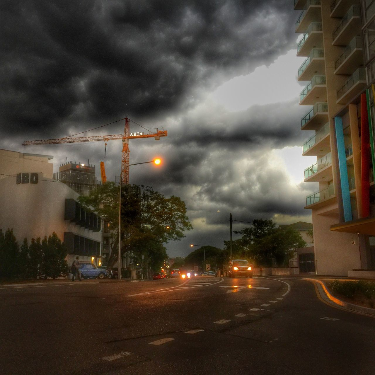 cloud - sky, sky, storm cloud, weather, built structure, architecture, dramatic sky, tree, street, outdoors, car, thunderstorm, transportation, no people, building exterior, road, illuminated, city, nature, night