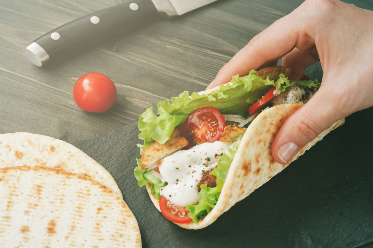 Close-up Day Egg Food Food And Drink Freshness Healthy Eating High Angle View Holding Human Body Part Human Hand Indoors  Lettuce Mexican Food One Person People Ready-to-eat Tomato Tortilla - Flatbread Vegetable Wrap Sandwich