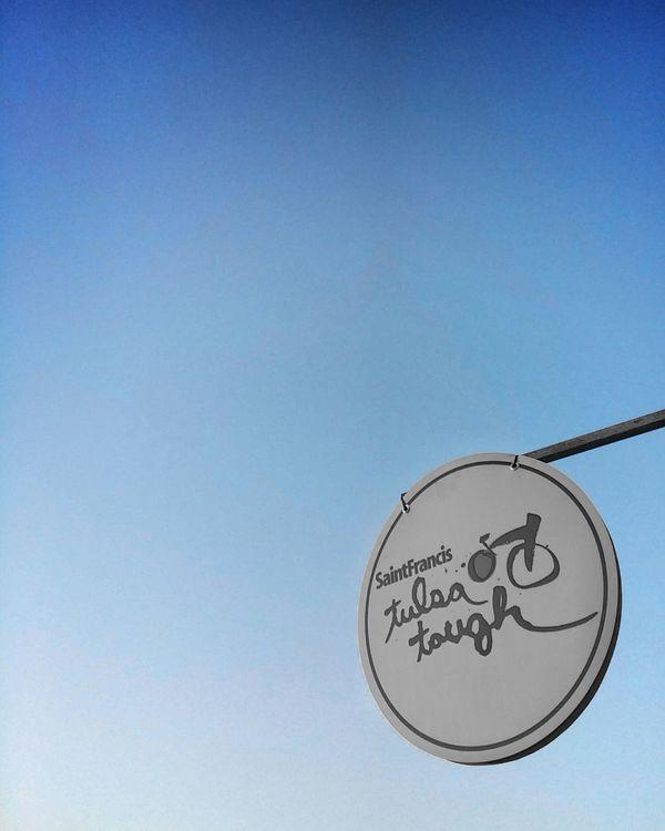 dangling Road Sign Clear Sky Outdoors Sign Design Lettering Sky City Logo Font Blue EyeEm Best Shots Racing Bicycle Race The Street Photographer - 2017 EyeEm Awards Bike Cycling View Bluesky Minimal Minimalmood Simple Minimalism Tulsatough Tv_simplicity