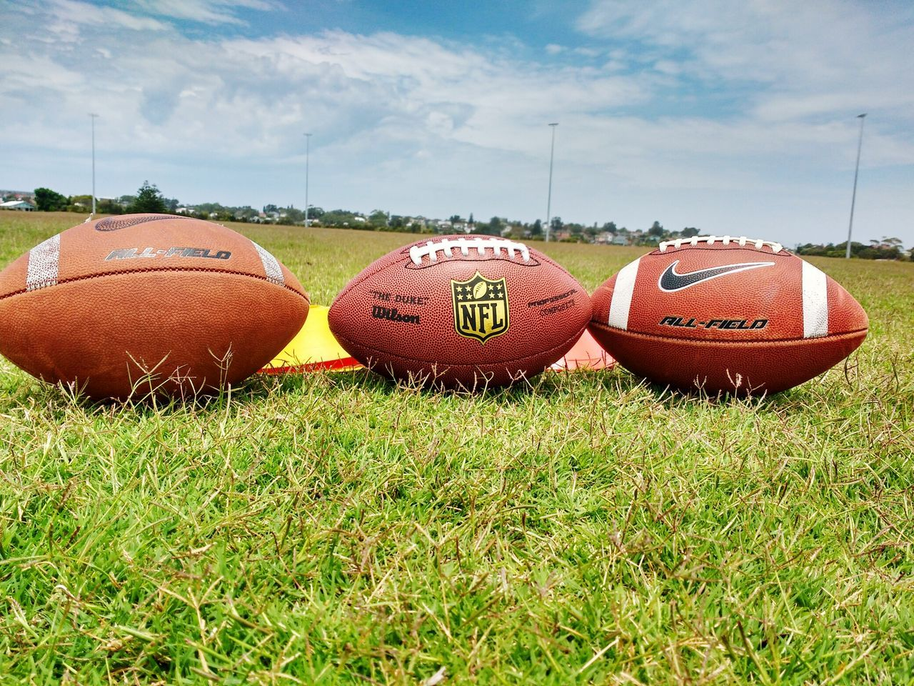 NFL NFL Football Outdoors Green Color Nature Sport Sky Cloud - Sky Grass No People Ball All Day Tree Landscape Nature