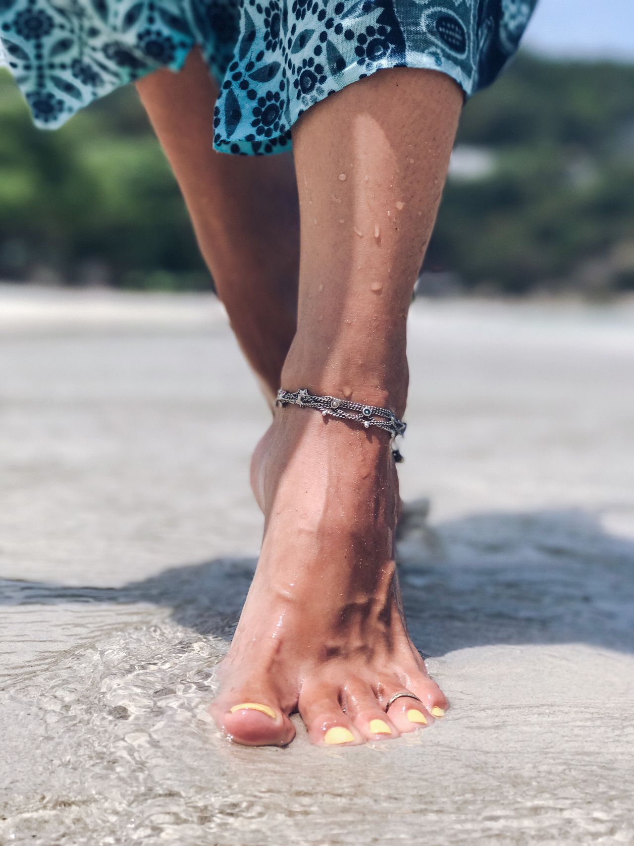 Real People One Person Low Section Outdoors Human Leg Wet Water Droplets Human Body Part Lifestyles Focus On Foreground Standing Leisure Activity Beach Women Water Human Hand Close-up Nail Polish Walking Human Foot Sand Blue Skirt Ankle Bracelet Jewelry Silver Bracelet