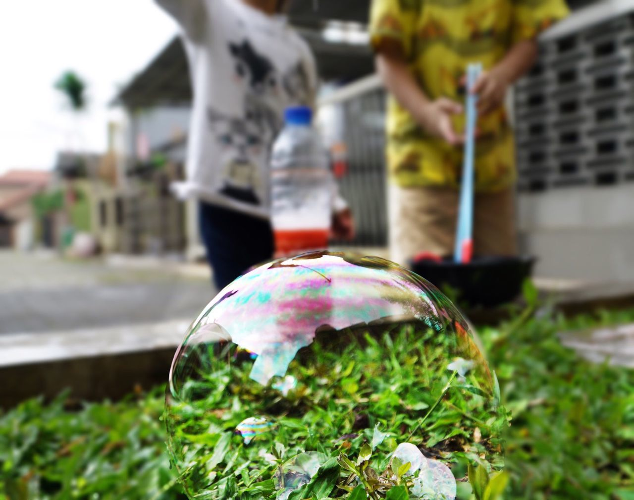 real people, day, outdoors, close-up, fragility, one person, nature, bubble wand