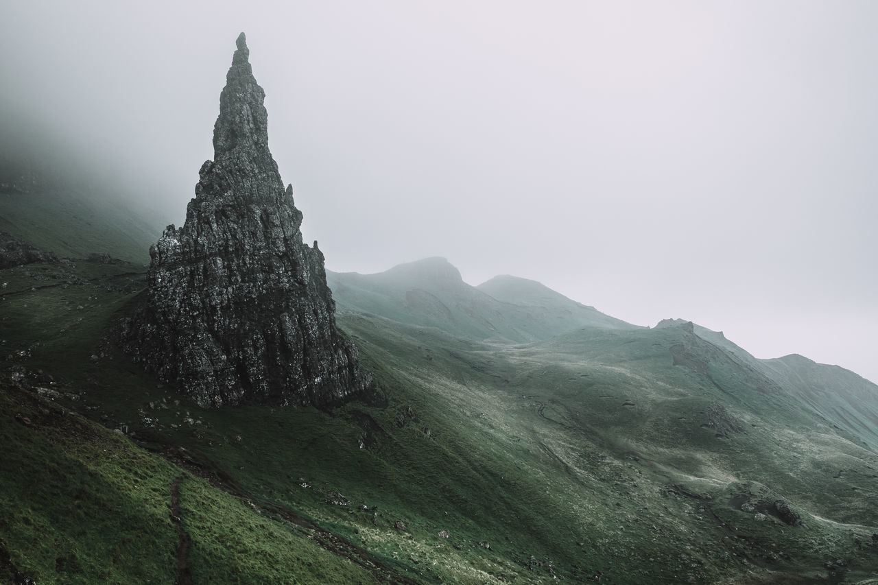 It's all about the mood. Location: Isle Of Skye, Scotland Equipment: Fujifilm X-T1 + XF18-55 Beauty In Nature Fujifilm Hill Idyllic Isle Of Skye Landscape Mood Moody Mountain Mystic Nature Old Man Of Storr Outdoors Rock Rock Formation Rocky Sanctuary  Scenics Schottland Scotland Sky Tranquil Scene Tranquility Travel Travel Destinations The Week On EyeEm The Great Outdoors - 2017 EyeEm Awards