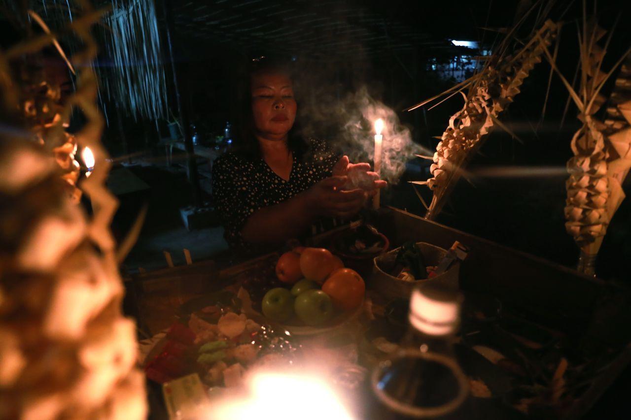 A Malaysian indigenous lady from Mah Meri tribe performs ritual prayer during the Spirit's Day eve at Kampong Sungai Bumbun, Pulau Carey in Selangor on March 8, 2016. Malaysia Mahmeri Pulaucarey Indigenous  Ritual Culture