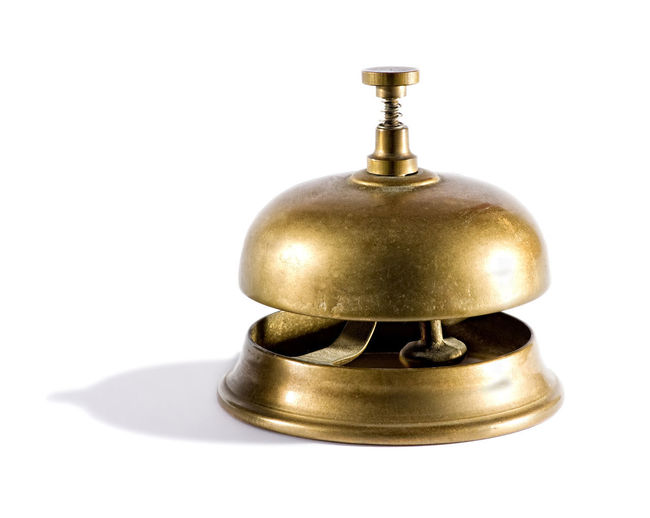 Vintage brass service bell usually found in a hotel or club reception for a customer to summon assistance on a white Attention Reception SUPPORT Summons Bell Brass Customenr Gold Colored Help Help Desk Hotel Metal Ring Service Studio Shot White Background