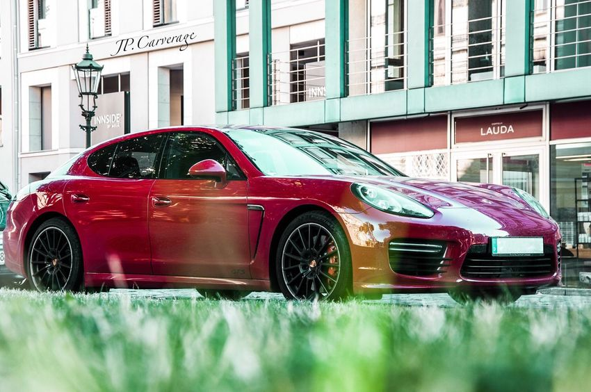 Good morning. Have to try Eye.Em out:) Car Porsche Panamera Gts First Eyeem Photo Carporn Luxury Goodlife Red Colors Nikon Transportation Creativity Selective Focus Grass Stationary Land Vehicle Mode Of Transport Outdoors Street