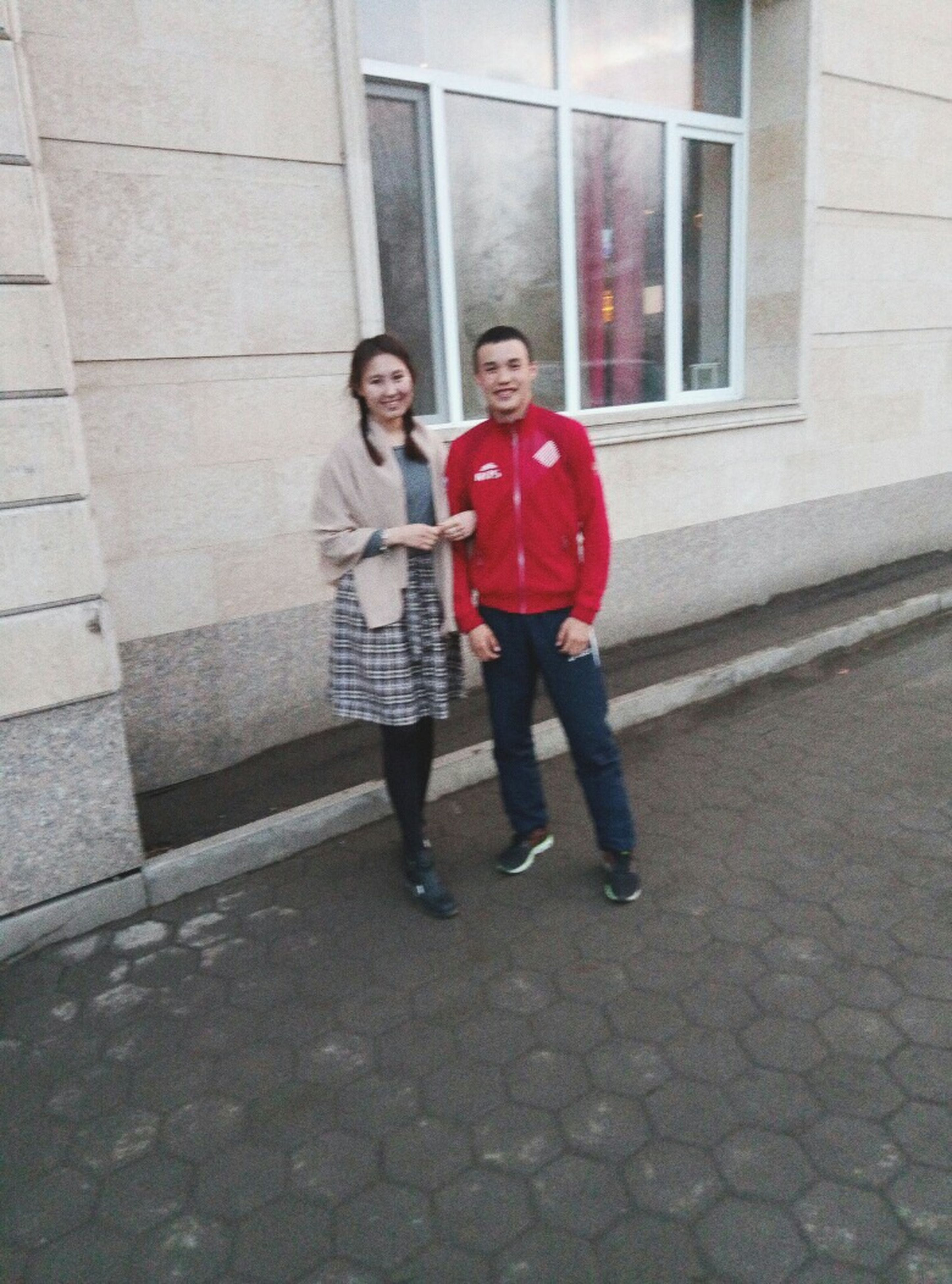 two people, full length, togetherness, red, city, looking at camera, adults only, mid adult, casual clothing, outdoors, portrait, happiness, front view, smiling, day, building exterior, built structure, facade, people, real people, adult, only women, architecture, friendship