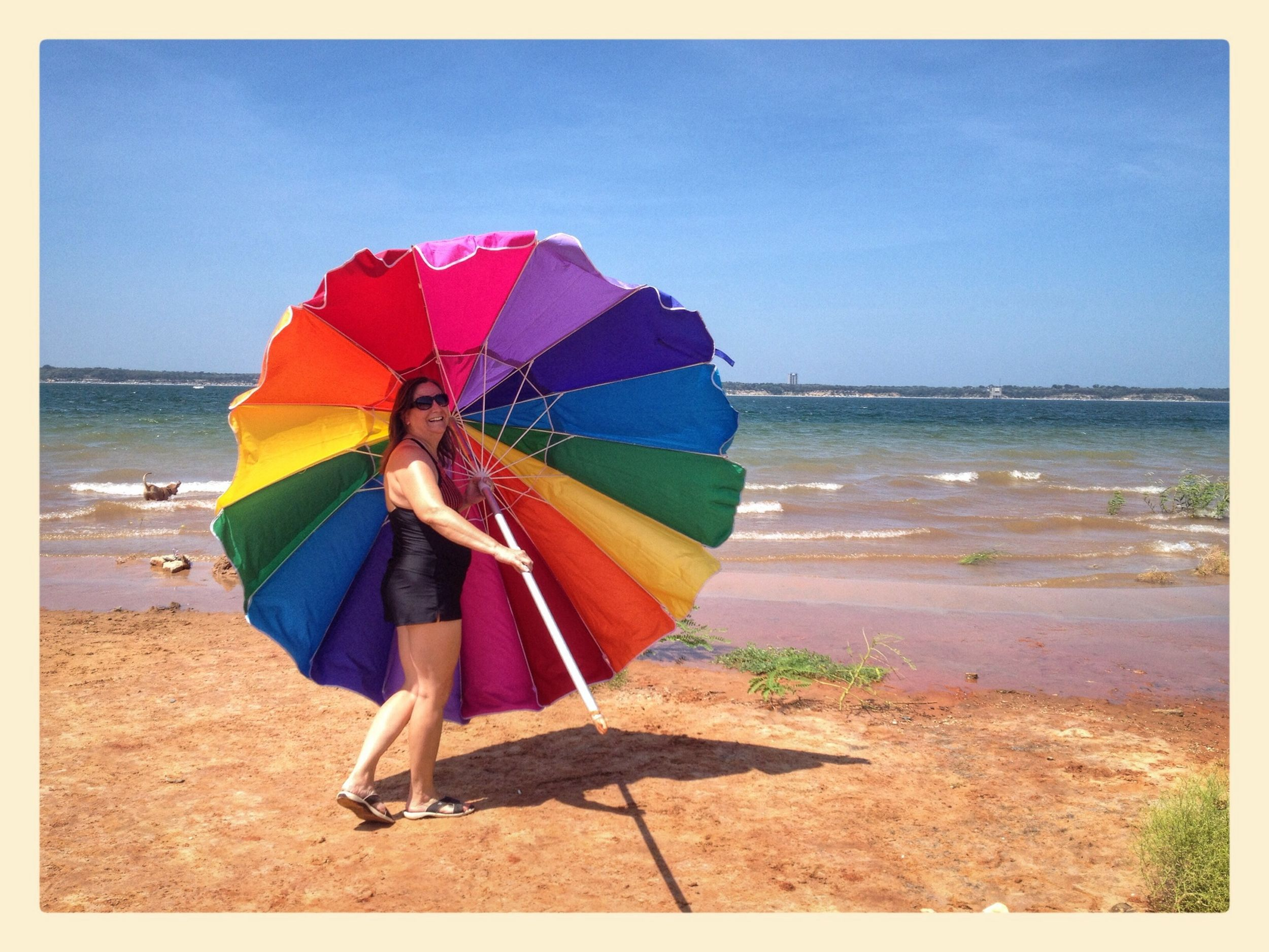 Cousin saving the Umbrella on a Windy Day at the Beach
