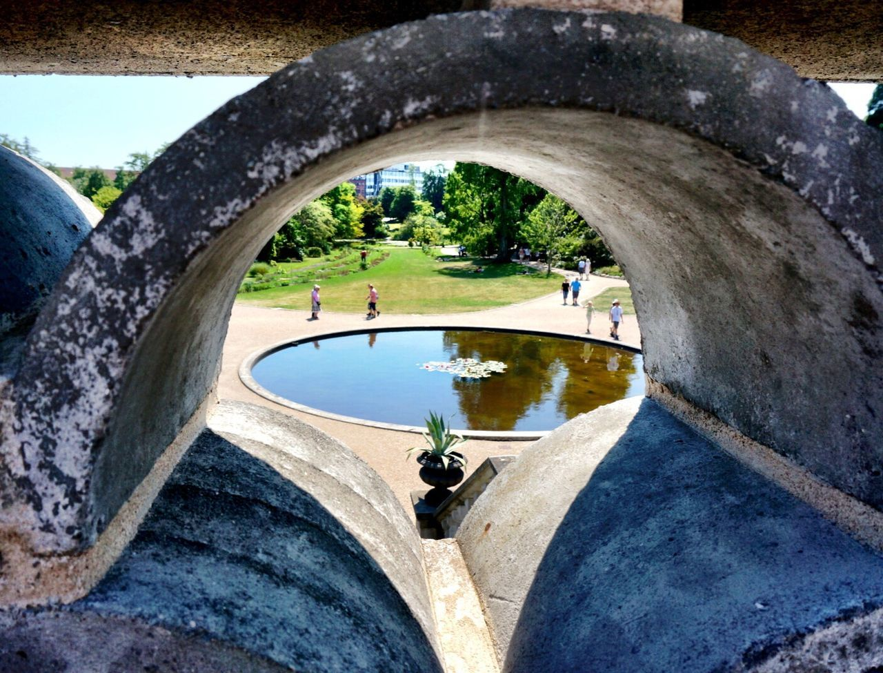 day, water, leisure activity, real people, sport, lifestyles, tree, two people, outdoors, architecture, men, fish-eye lens, nature, skateboard park, sky, people