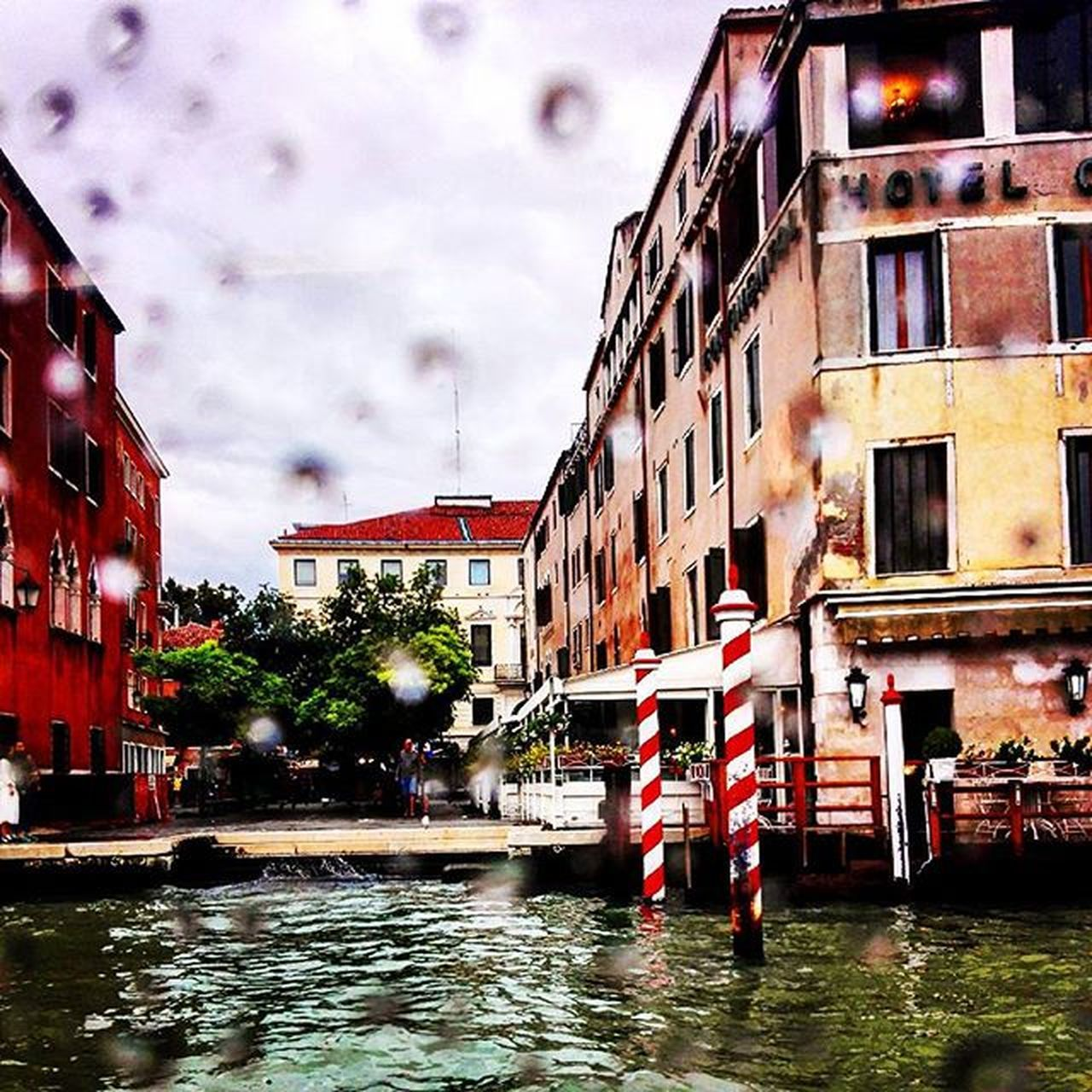 building exterior, architecture, water, built structure, waterfront, outdoors, cloud - sky, sky, canal, wet, flood, city, day, puddle, no people