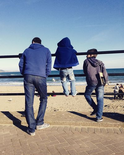 Beach Blue Brothers Clear Sky Day Family Father&son Horizon Over Water Leisure Activity Men Nature Outdoors People Real People Rear View Sky Standing Sunlight Togetherness Walking Water