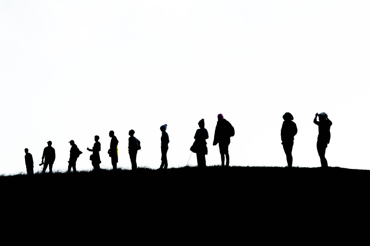 silhouette, men, large group of people, walking, real people, lifestyles, women, togetherness, clear sky, standing, leisure activity, white background, army soldier, sky, nature, full length, outdoors, day, beauty in nature, adult, people