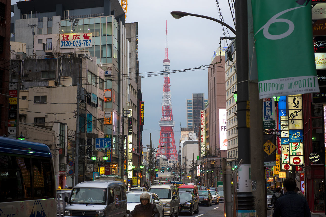 A busy Tokyo with Tokyo Tower City Iconic Buildings Iconic Tower Tokyo Tokyo Tower Tourism Travel Travel Destinations